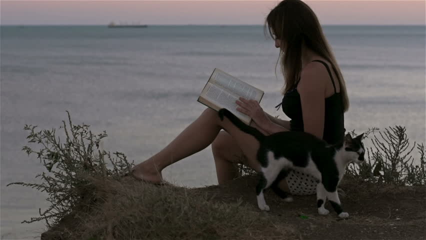 Reading a book on beach side