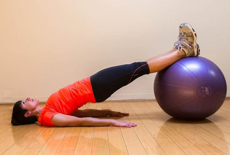 Glute bridges with stability ball
