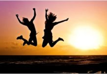 Girls jumping happily