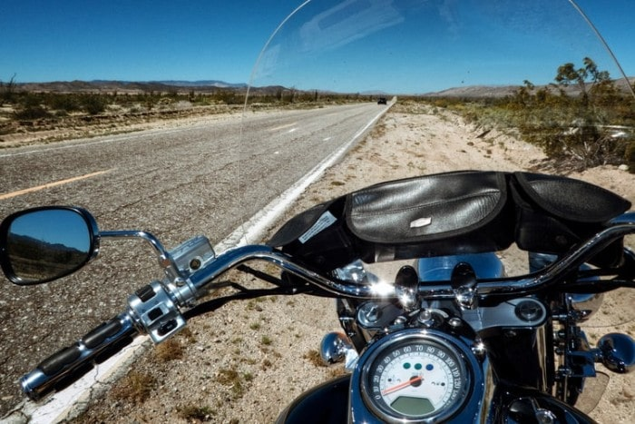 touring motorcycle beside a road