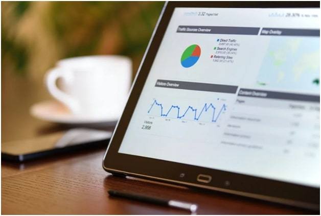 A black tablet showing SEO ranking factors on its screen with data points to help small business owners with SEO marketing