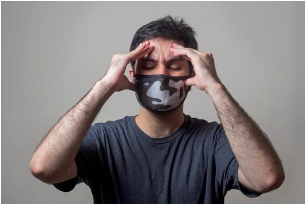A man experiencing a migraine